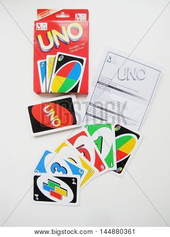 St.Petersburg, Russia - August 30: Uno card game original box deck of cards isolated on white background. Uno - one of the most popular board games in the world.