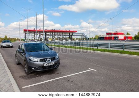 TVER REGION, RUSSIA - JUNE 26 2016: Charging point on the toll road. Russian highway number M11
