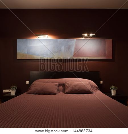 Vertical view of bedroom with big bed