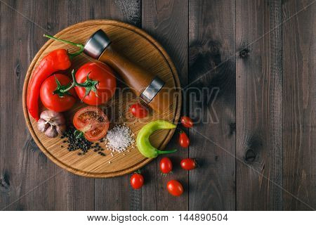 Fresh Tomatoes And Coarse Salt For Use As Cooking Ingredients With A Halved Tomato