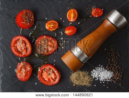 Food Ingredients: Tomatoes And Salt On Black Slate Stone. Top Flat View
