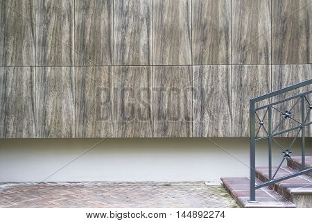 Fragment of a wall by entrance to the modern residental house for background. Copy space for text