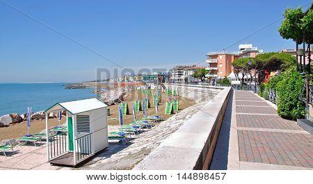 Promenade and Beach of Caorle at adriatic Sea in Veneto,venetian Riviera,Italy
