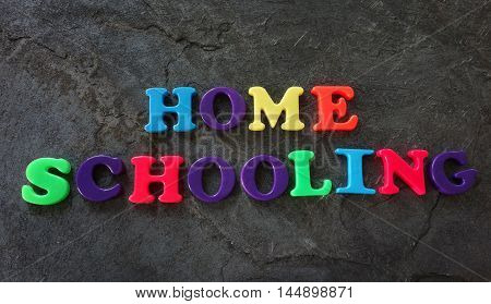 Home Schooling spelled out in colorful play letters