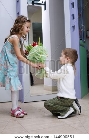 little boy makes offer hands and hearts