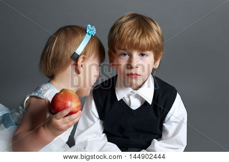 photo of little funny boy ignoring girl