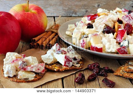 Crisps Topped With Autumn Themed Topping Of Chicken, Apples, Nuts And Cranberries, Still Life