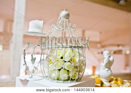 Decorated Cage And Candles On Wedding Reception