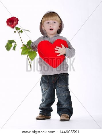little boy with rose and heart on white