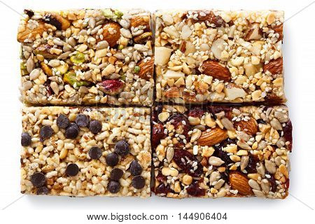 Four Fruit, Nut And Seed Bars With Pistachios, Cranberries, Brazil Nuts And Chocolate Chips Isolated