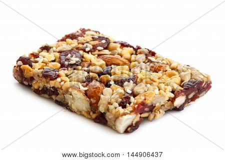 Fruit, Nut And Seed Bar With Cranberries Isolated On White.