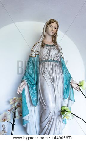 Statue of holy woman isolated on light background