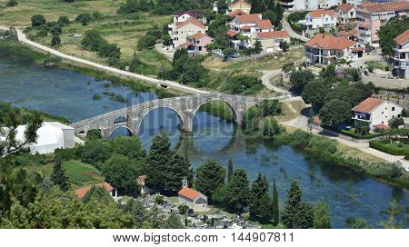 Arslanagica Most over Trebisnjica River in Trebinje Bosnia also known since 1993 as Perovica Bridge. Built by Ottomans in 1574 it was moved and physically rebuilt in 1970 a few kilometres from its orginal location.