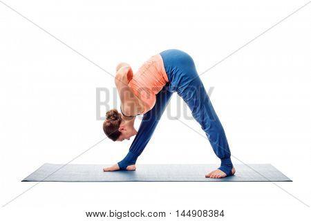 Woman doing Ashtanga Vinyasa Yoga asana Parsvottanasana - intense side stretch pose isolated on white background