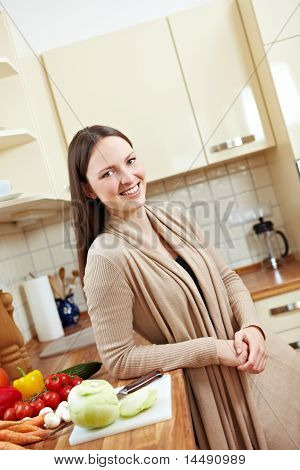 Woman In Kitchen With Vegetables
