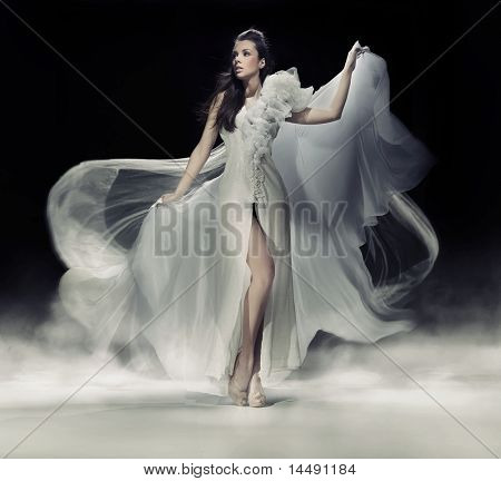 Dynamic image of a beautiful woman shot in studio