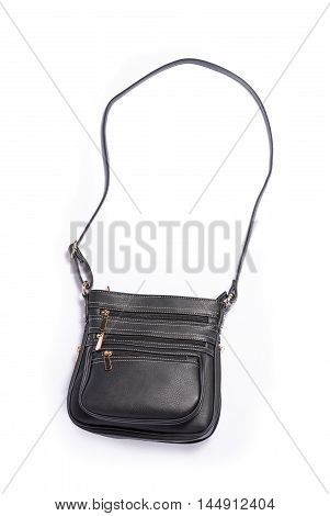 Black leather side bag on white background