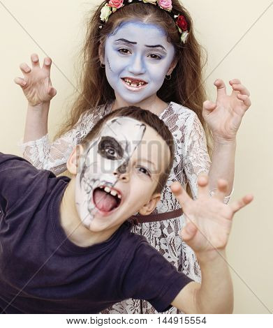 zombie apocalypse kids concept. Halloween party celebration facepaint on children dead bride, scar face, skeleton together, lifestyle real children concept