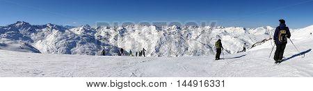 Alpine Ski In Snow Mountains Panoramic View