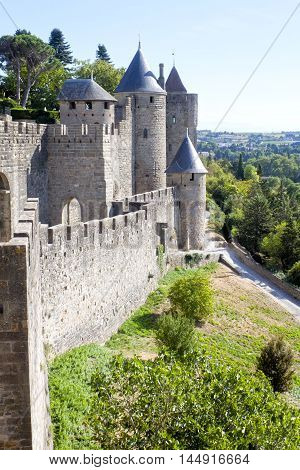 Carcassonne City Surrounded Of Trees And Grass In France