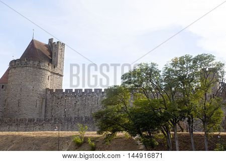 Tower And The Wall Of Carcassonne City With Some Trees, France