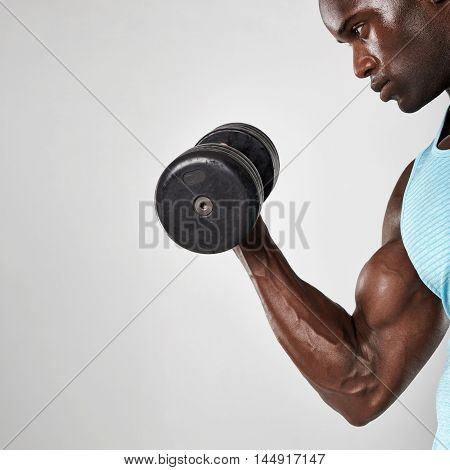African Man Doing Biceps Curl With Dumbbell