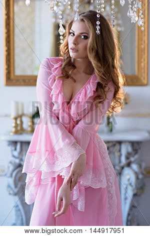 Beautiful Sexy Lady In Elegant Pink Robe. Close Up Fashion Portrait Of Model Indoors. Beauty Blonde