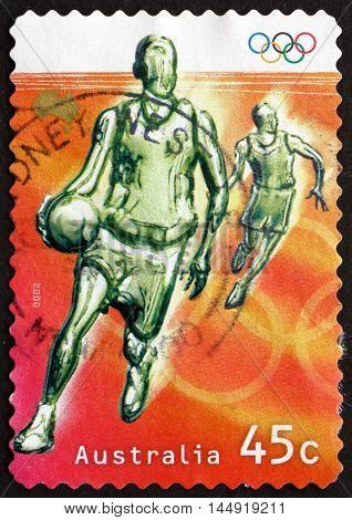 AUSTRALIA - CIRCA 2000: a stamp printed in Australia shows Basketball Olympic Sport circa 2000