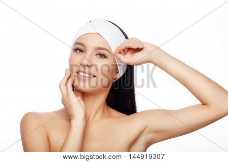 Young Woman in Hairband Touching her Face with a Perfectly Clean Skin. Happy Woman after Bath with Clean Perfect Skin. Skin Care, Cosmetics and Makeup Concept.