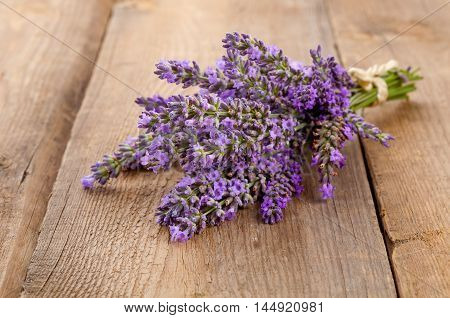 Bunch of lavender flowers on wooden background