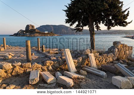 Landscape with archaeological site and islet at sunset in Kos island, Greece