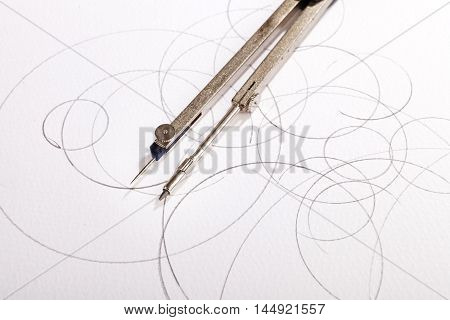 pair of compasses drawing on a white paper