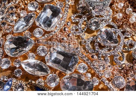 Collection of assorted luxury precious golden and silver gemstone background