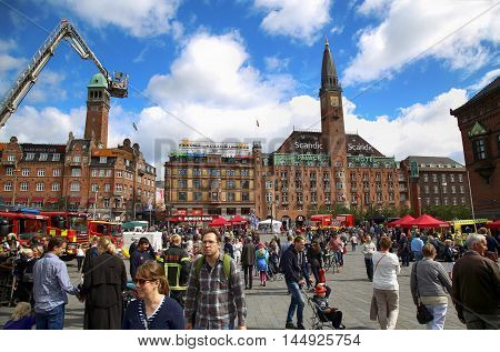 COPENHAGEN DENMARK - AUGUST 14 2016: Scandic Palace Hotel is a residential hotel on City Hall Square and many pedestrians tourist in the City Hall square in Copenhagen Denmark on August 14 2016.