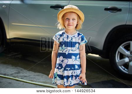 portrait of a little girl in a fun straw hat