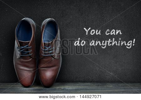 You can do anything text on black board and business shoes on wooden floor