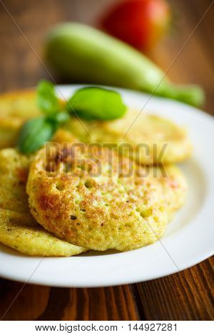 fried zucchini fritters with dill on a plate