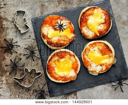 Halloween food ideas for kids party - pizza with tomato and cheese top view