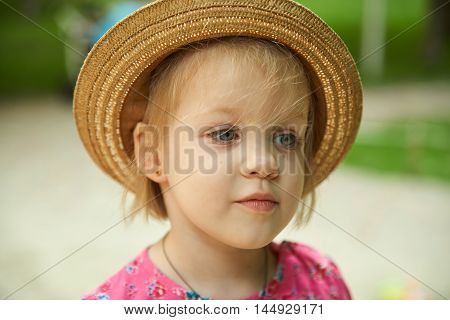 The cute kid girl wearing hat outdoors.