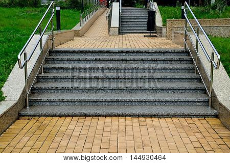 Ramp for wheelchair entry and stairs with railings
