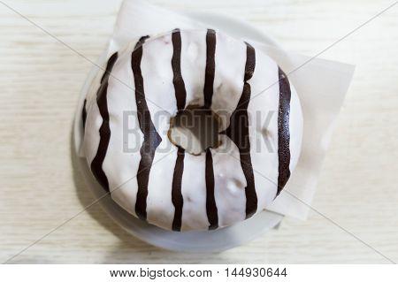 donut glazed with dark chocolate and white