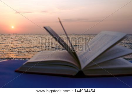 Book on the beach. Back to school. Seaview. Copy space for text.