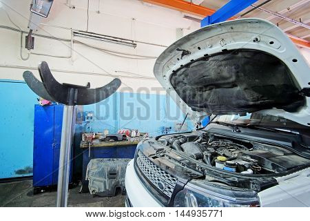 Car with open hood in a repair station in Moscow, Russia