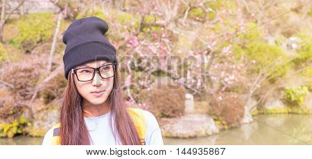 Japanese girl with glasses in a Plum blossom garden