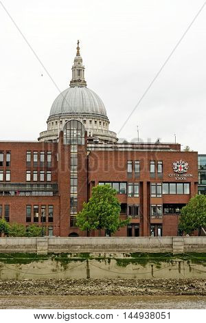 LONDON ENGLAND - JULY 8 2016: Dome of the St.Paul`s Cathedral and the City of London School.