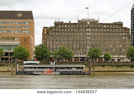 LONDON ENGLAND - JULY 8 2016: London Fire Brigade Headquarters building and the International maritime organization on Albert Embankment on the south bank of Thames river.