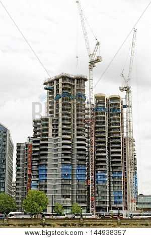 LONDON ENGLAND - JULY 8 2016: The construction of the new mixed used development - The Corniche at Albert Embankment in Nine Elms Battersea Regeneration Area. It is due to be comleted in 2017.