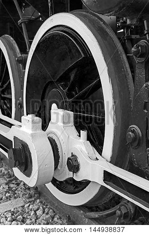 Old german steam locomotive built in 1940 in a museum. The heaviest locomotive 85 tons that circulated in Romania during the Second World War. Detail and close up of huge wheels. B & W processing.