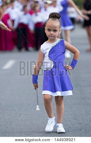 GOTTLOB ROMANIA - AUGUST 14 2016: Parade of small cheerleaders with occasion Festival of watermelon