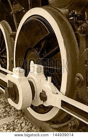Old german steam locomotive built in 1940 in a museum. The heaviest locomotive 85 tons that circulated in Romania during the Second World War. Detail and close up of huge wheels. Sepia processing.